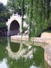 Arched Marble Bridge Across Lake
